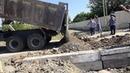 Gəncə şosesi, sel-su kanalının təmizlənməsi və körpü altı su ötürücü metal borunun yenilənməsi